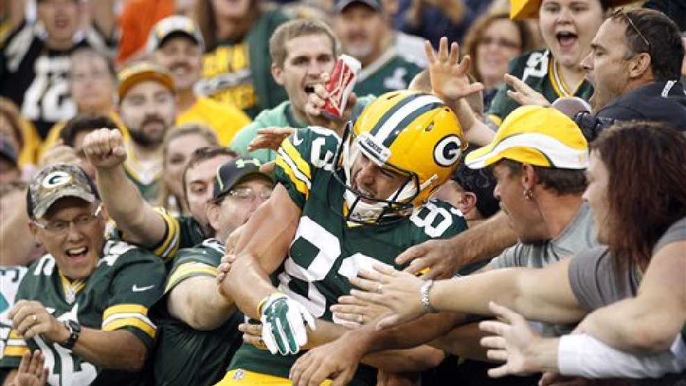 Green Bay Packers' Jeff Janis celebrates with fans after catching a touchdown pass during the first half of an NFL football preseason game against the Kansas City Chiefs Thursday, Aug. 28, 2014, in Green Bay, Wis. (AP Photo/Mike Roemer)