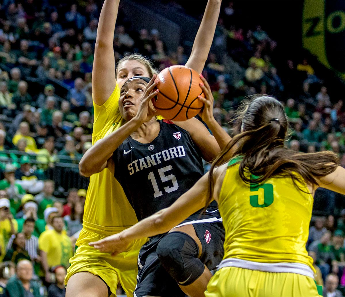 The Cardinal's Maya Dodson (#15) goes up for the basket. The Stanford Cardinal defeated the Oregon Ducks 78-65 on Sunday afternoon at Matthew Knight Arena. Stanford is now 10-2 in conference play and with this loss the Ducks drop to 10-2. Leading the Stanford Cardinal was Brittany McPhee with 33 points, Alanna Smith with 14 points, and Kiana Williams with 14 points. For the Ducks Sabrina Ionescu led with 22 points, Ruthy Hebard added 16 points, and Satou Sabally put in 14 points. Photo by August Frank, Oregon News Lab