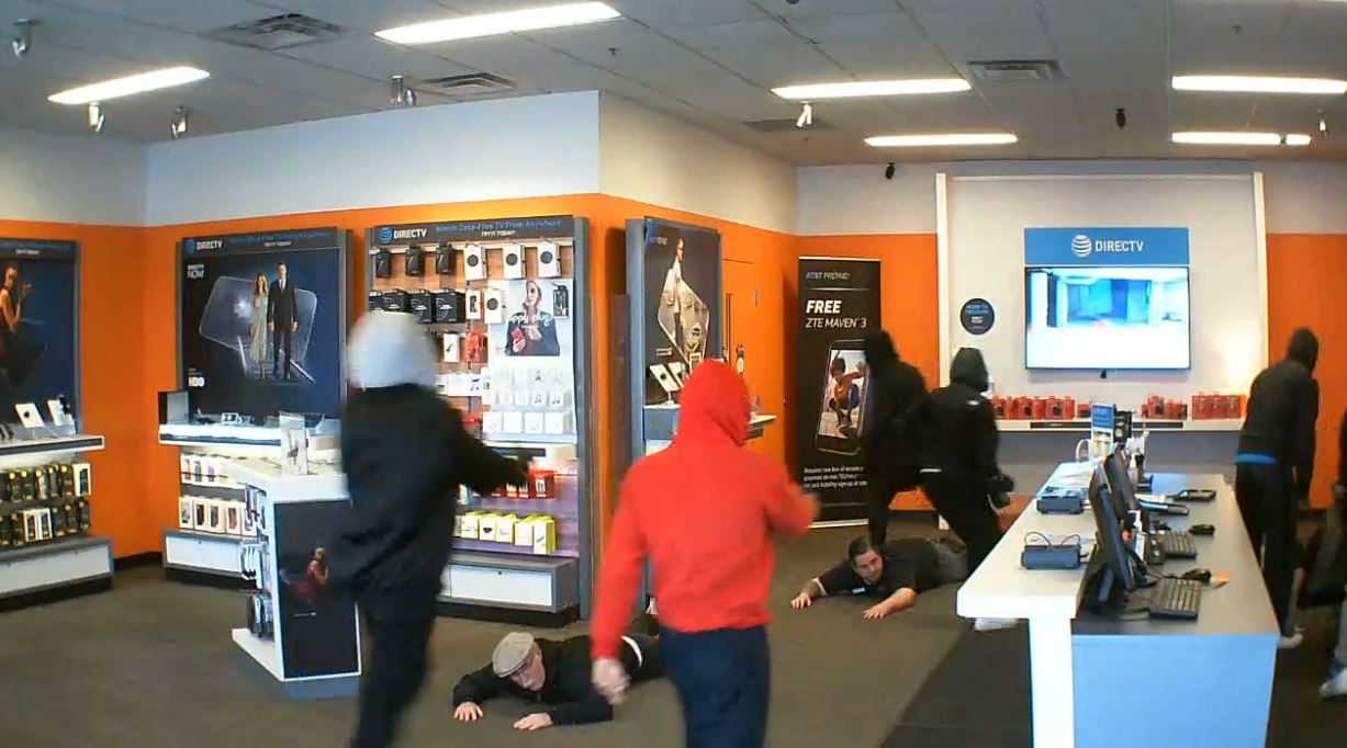 7 in custody after armed robbery at Huber Heights AT&T store (Surveillance footage courtesy AT&T authorized retailer)
