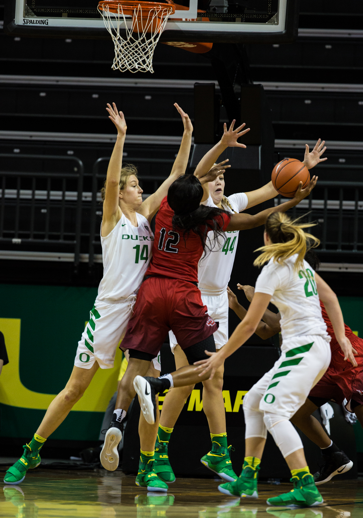 Lamar Cardinals forward Kiara Desamours (#12) attemps a layup as Ducks defenders Lydia Giomi (#14), Mallory McGwire (#44) and Sabrina Ionescu (#20) try to stop her. The Oregon Ducks Women's basketball team won their season opener against the Lamar Cardinals 84-67.  Photo by Austin Hicks, Oregon News Lab