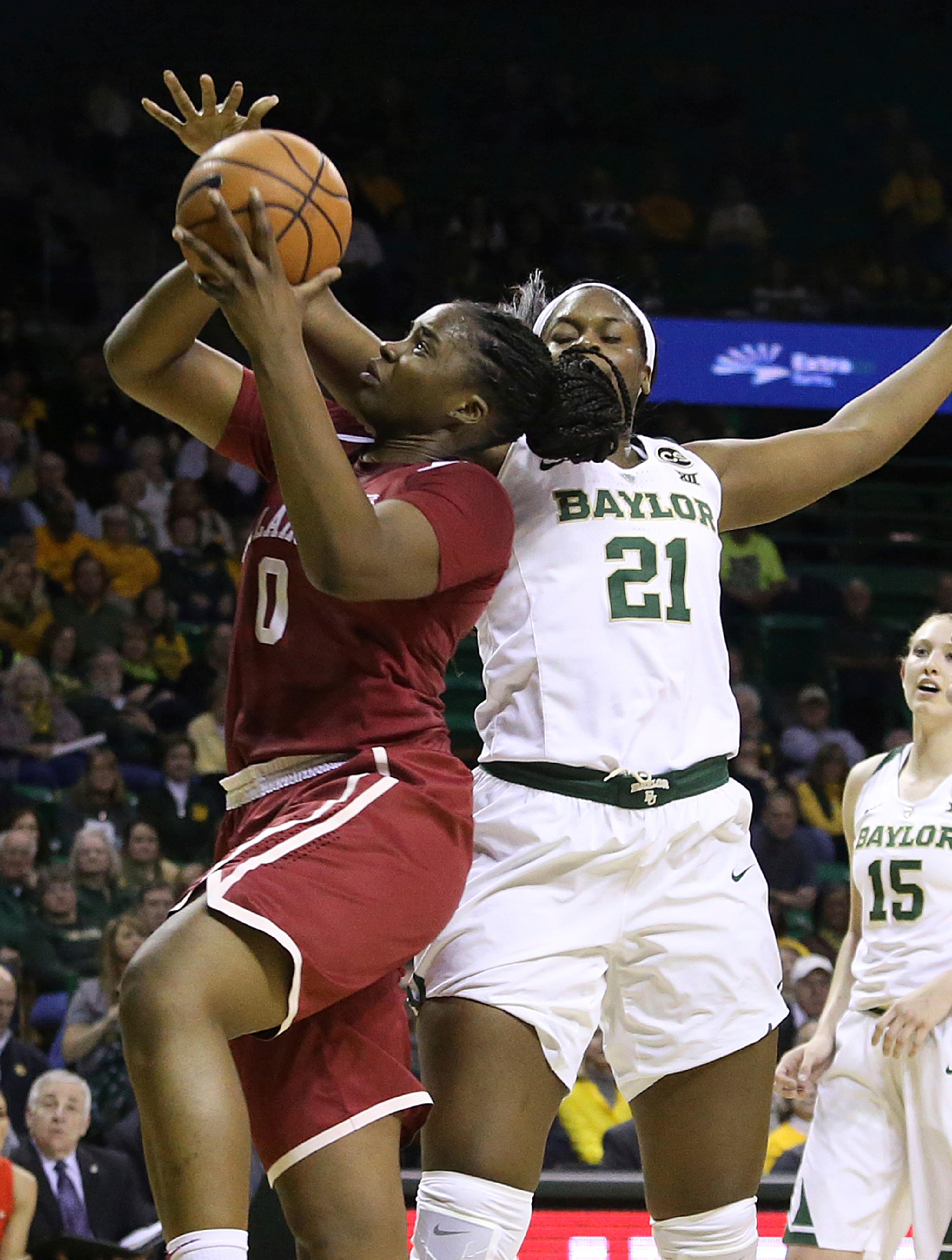 Oklahoma center Vionise Pierre-Louis, left, is fouled by Baylor center Kalani Brown, right, during the first half of an NCAA college basketball game, Monday, Feb. 5, 2018, in Waco, Texas. (AP Photo/Jerry Larson)