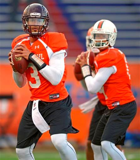 North Squad quarterback Logan Thomas of Virginia Tech (3) drops back with fellow quarterbacks Tajh Boyd of Clemson (10), middle, and Stephen Morris of Miami (17), right, during Senior Bowl practice at Ladd-Peebles Stadium, Jan. 20, 2014, in Mobile, Ala.