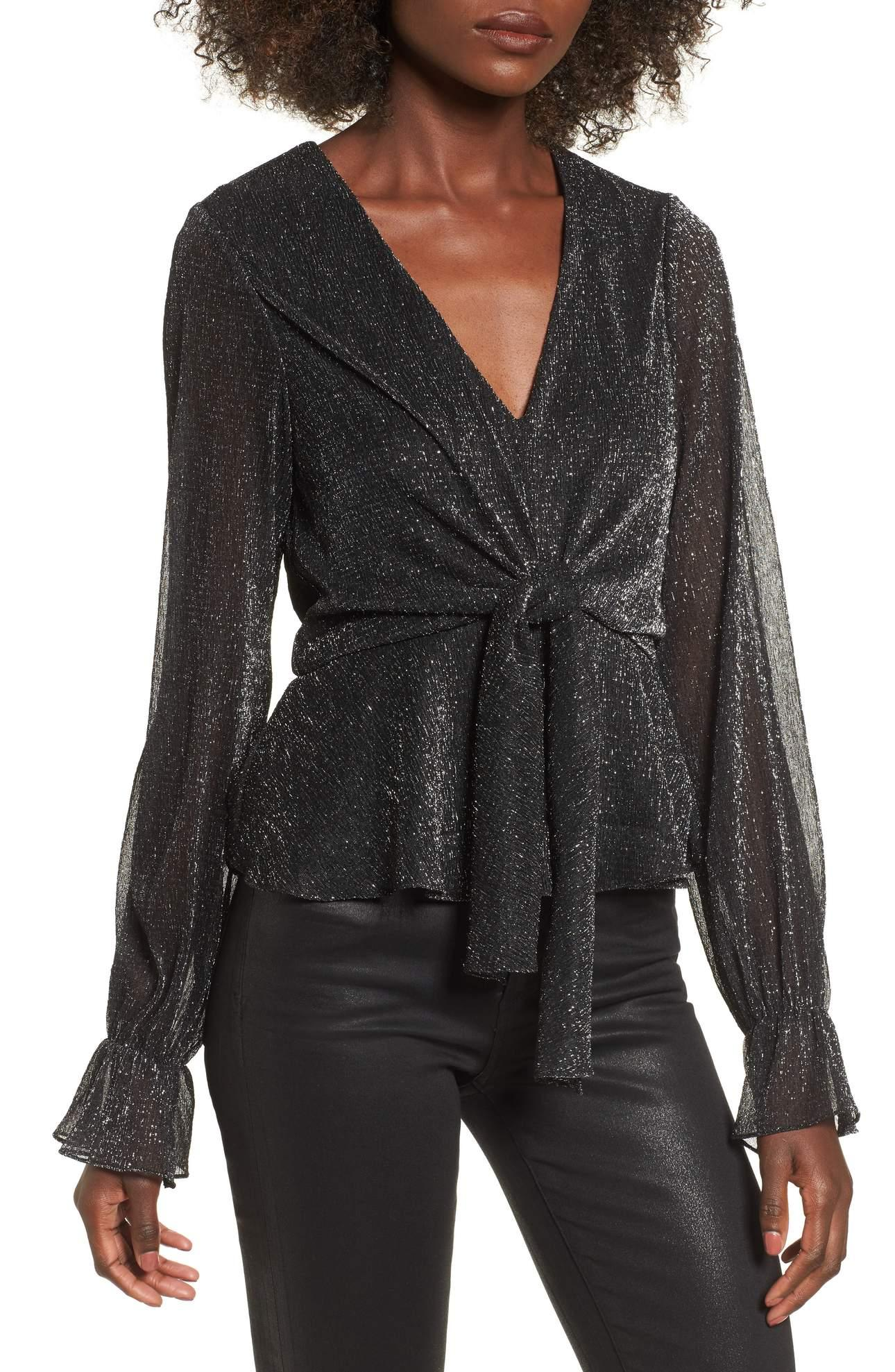 <p>Metallic Tie Front Top - $49. This Metallic Tie Front Top is not only perfect for NYE but you can totally wear it again, and again.{&amp;nbsp;} Pair with a pair of black skinny jeans and colorful heels. (Image: Nordstrom){&amp;nbsp;}</p><p></p>