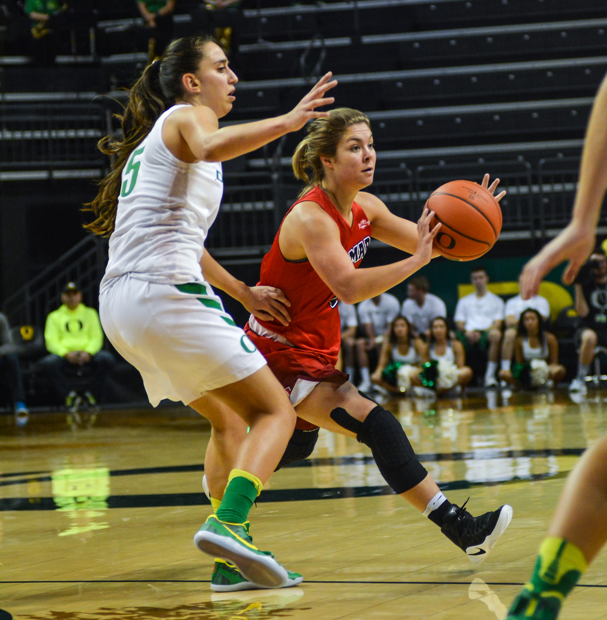 Cardinals Baileigh O'Dell (#5) passes the ball to a teammate. The Oregon Ducks women's basketball team won their season opener against the Lamar Cardinals 84-67. Photo by Jacob Smith, Oregon News Lab