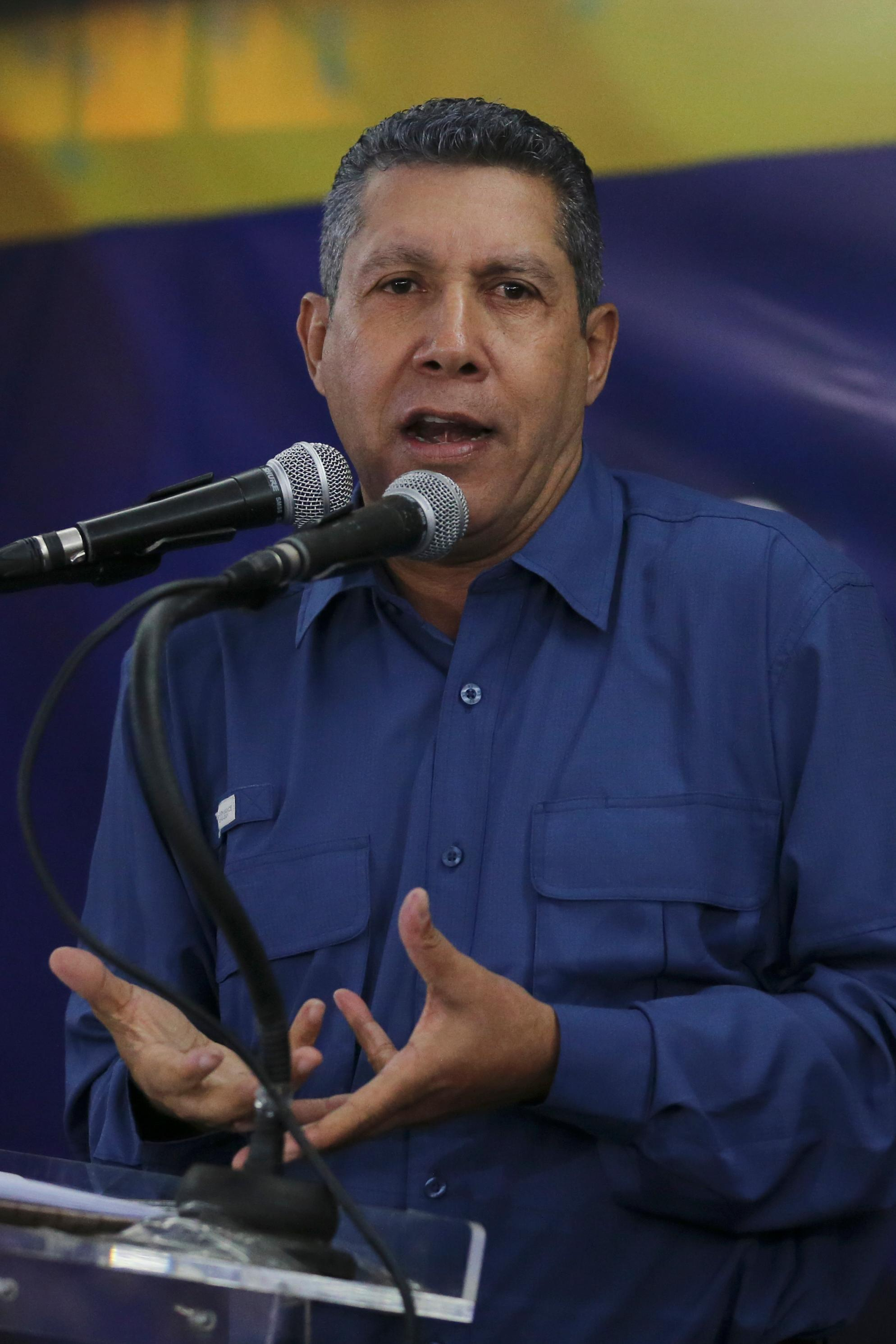 Anti-government presidential candidate Henri Falcon addresses supporters in Caracas, Venezuela, Sunday, May 20, 2018. Falcon said that the presidential election was marred by irregularities and lacks legitimacy. (AP Photo/Fernando Llano)