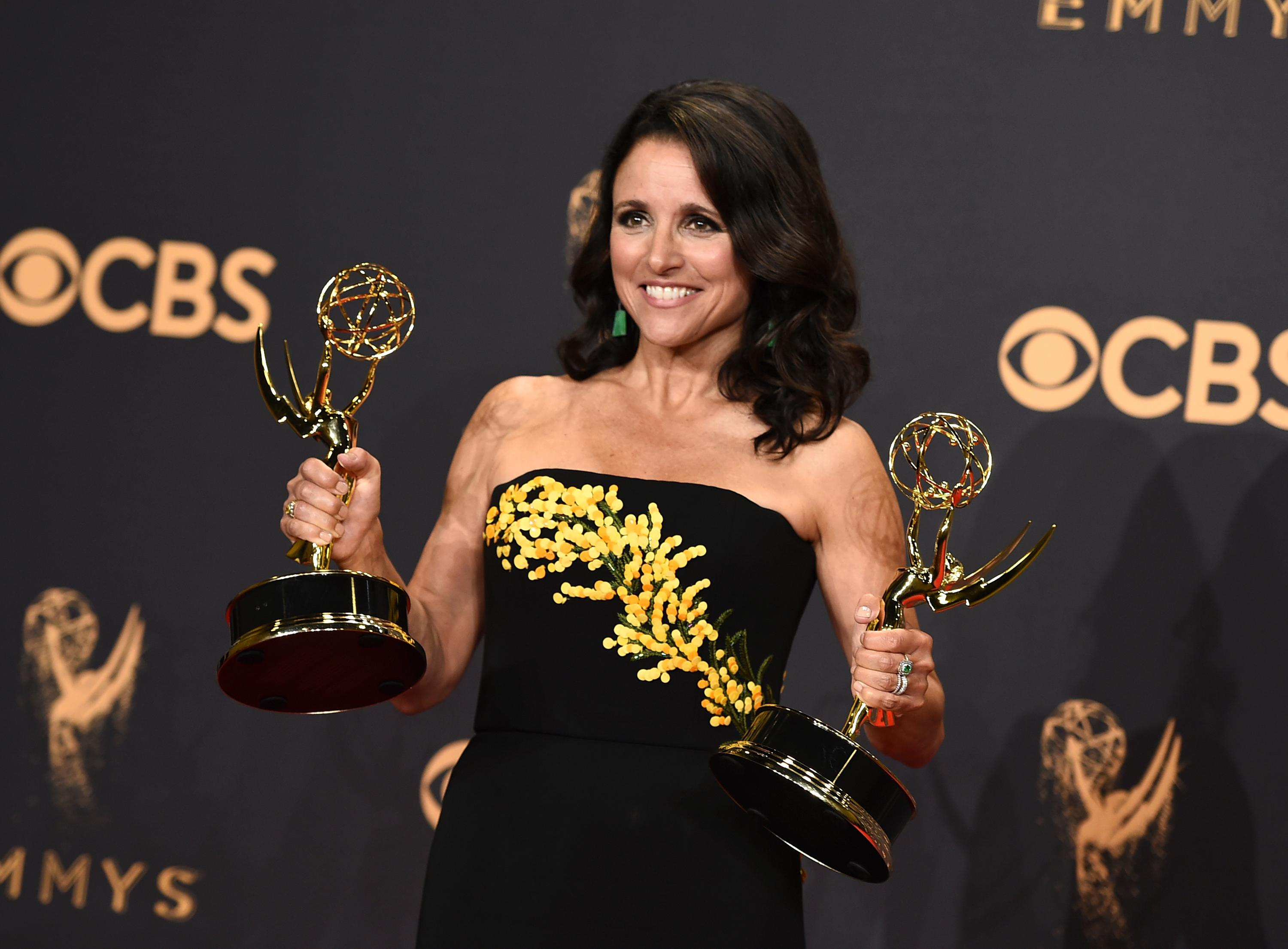 "FILE - In this Sunday, Sept. 17, 2017 file photo, Julia Louis-Dreyfus poses in the press room with her awards for outstanding lead actress in a comedy series and outstanding comedy series for ""Veep"" at the 69th Primetime Emmy Awards at the Microsoft Theater in Los Angeles. On Friday, Jan. 12, 2018, Julia Louis-Dreyfus marked the end of chemotherapy by posting a video on Instagram of her grown sons lip-syncing to Michael Jackson's ""Beat It."" (Photo by Jordan Strauss/Invision/AP)"