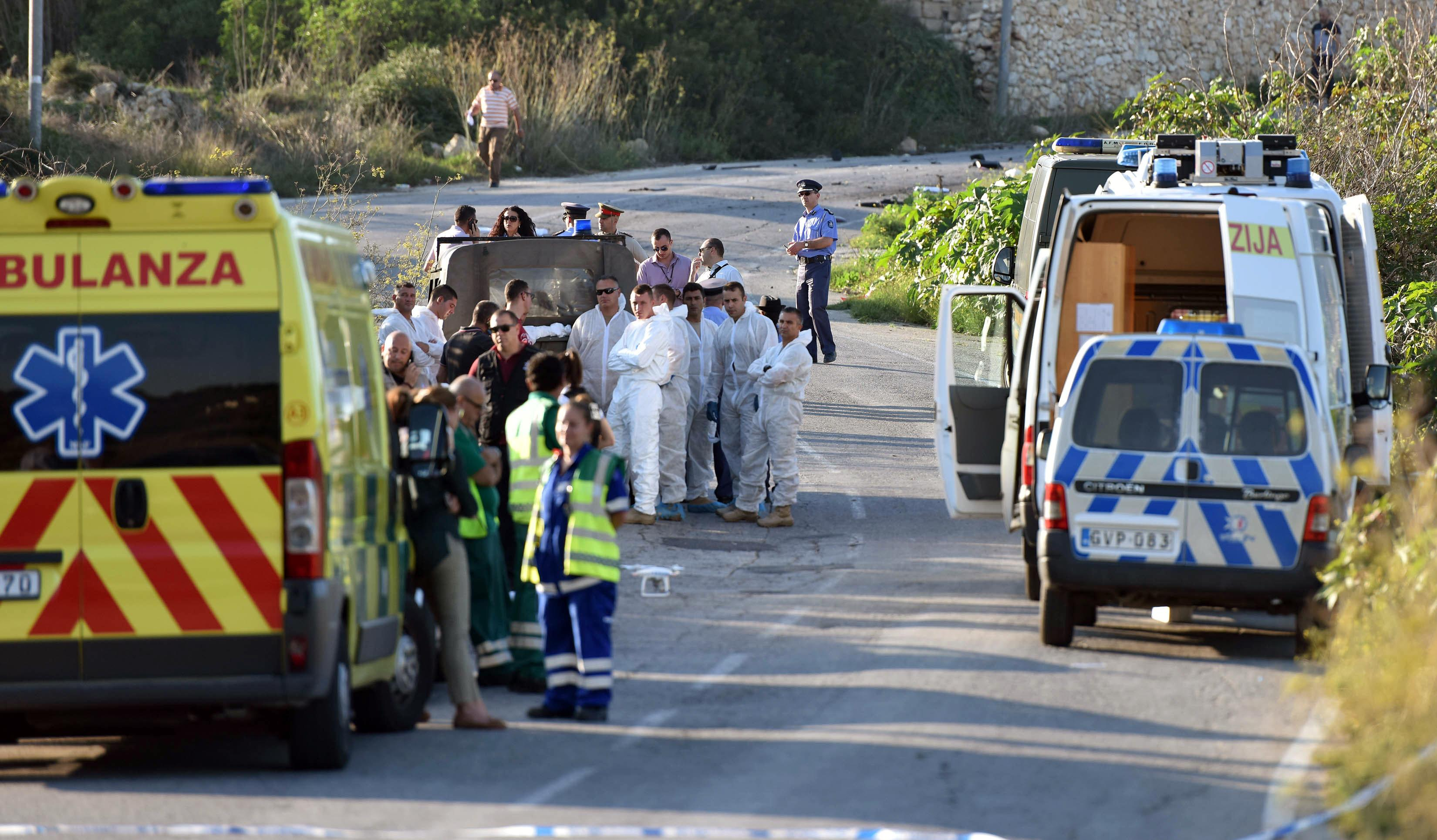 An ambulance is parked along the road where a car bomb exploded killing investigative journalist Daphne Caruana Galizia, in the town of Mosta, Malta, Monday, Oct. 16, 2017. Malta's prime minister says a car bomb has killed an investigative journalist on the island nation. Prime Minister Joseph Muscat said the bomb that killed reporter Daphne Caruana Galizia exploded Monday afternoon as she left her home in a town outside Malta's capital, Valetta. (AP Photo/Rene Rossignaud)