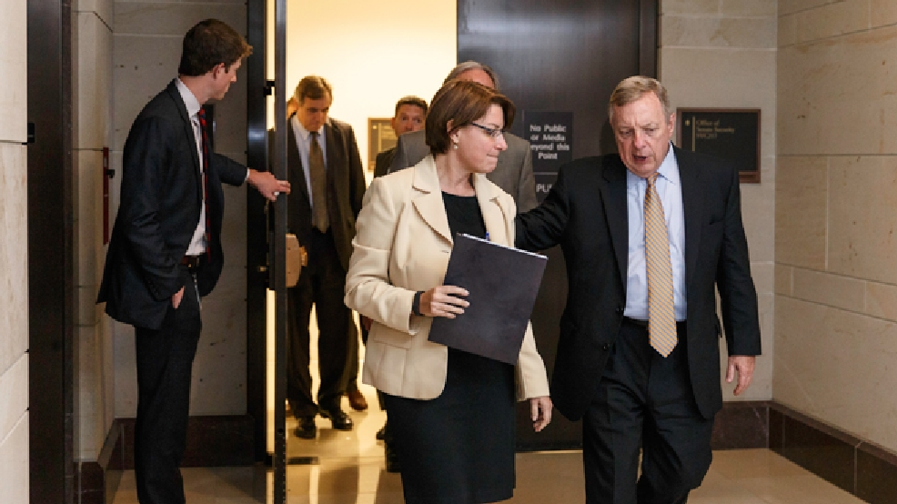 Senate Majority Whip Dick Durbin, D-Ill., right, Sen. Amy Klobuchar, D-Minn., center, and other senators emerge from a closed-door briefing with intelligence officials about the Obama administration's decision to swap five members of the Taliban for captive Army Sgt. Bowe Bergdahl, at the Capitol in Washington, Wednesday, June 4, 2014. (AP Photo/J. Scott Applewhite)