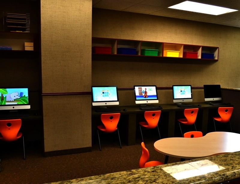 Interactive child center featuring a computer center equipped with iMacs.