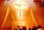 An Oshkosh church adds a new cross above its alter