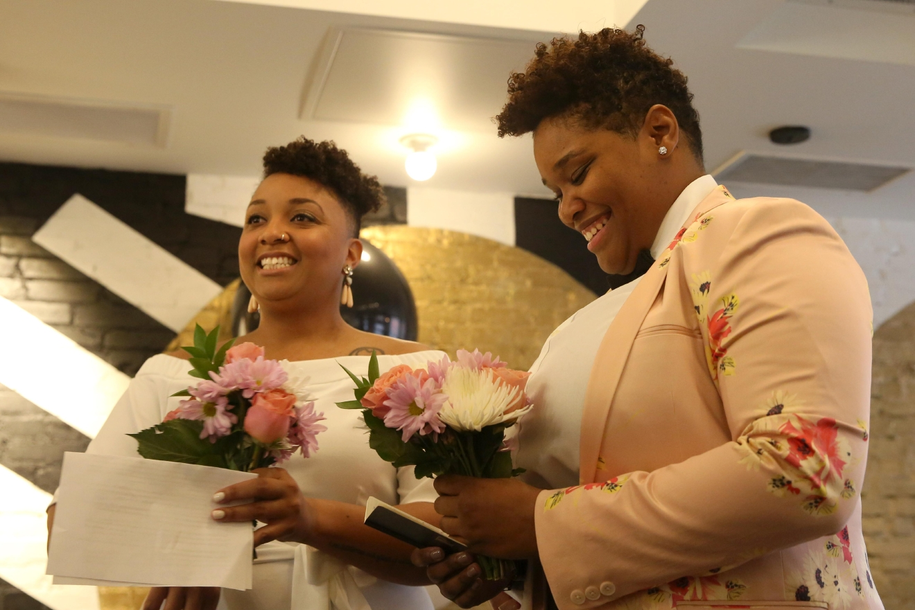 "Alicia and Keondra, who adopted the surname Freemyn after saying their vows, have been dating for nearly 5 years, but the first 365 days involved a lot of dates to &pizza. ""Pizza is central to our relationship,"" laughed Alicia, who explained it's also her favorite food. (Amanda Andrade-Rhoades/DC Refined)"