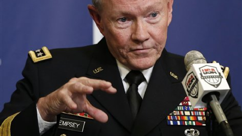 "This Aug. 20, 2014 file photo shows Joint Chiefs Chairman Gen. Martin Dempsey speaking in New York. President Barack Obama's military leadership made clear in recent days that the threat from the Islamic State militants, who murdered American journalist James Foley, cannot be fully eliminated without going after the group in Syria, as well as Iraq.""This is an organization that has an apocalyptic, end-of-days strategic vision and which will eventually have to be defeated,"" said Dempsey. ""Can they be defeated without addressing that part of their organization which resides in Syria? The answer is no. That will have to be addressed on both sides of what is essentially at this point a nonexistent border."" (AP Photo/Kathy Willens, File)"