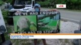 Algae protesters try to get Senator Marco Rubio's attention