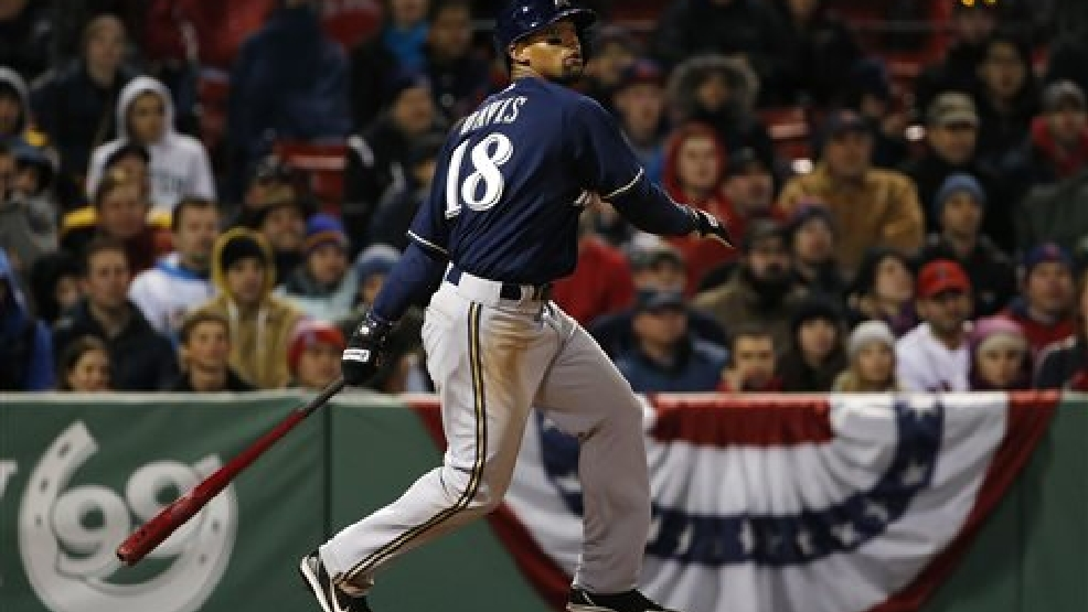 Milwaukee Brewers' Khris Davis watches his double against the Boston Red Sox during the eleventh inning of a baseball game at Fenway Park in Boston, Saturday, April 5, 2014. (AP Photo/Winslow Townson)