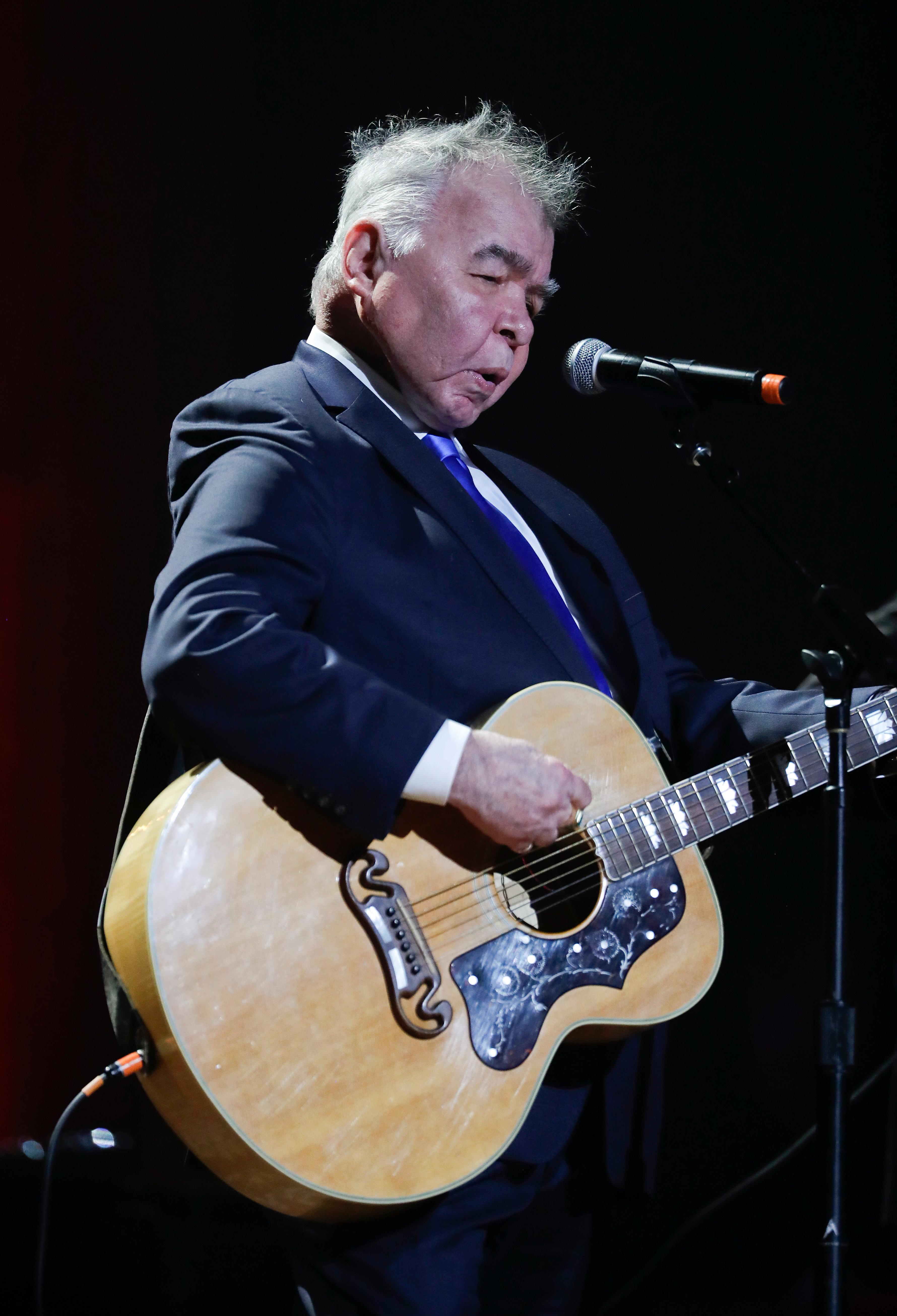 FILE - In this Wednesday, Sept. 13, 2017 file photo, John Prine performs during the Americana Honors and Awards show in Nashville, Tenn. Missy Elliott is making history as the first female rapper inducted into the Songwriters Hall of Fame, whose 2019 class also includes legendary British singer Cat Stevens and country-folk icon Prine and others announced Saturday, Jan. 12, 2019, by the organization. (AP Photo/Mark Zaleski, File)