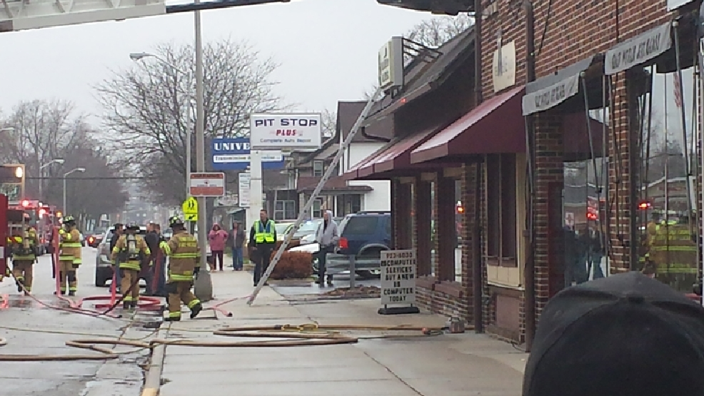 Firefighters on the scene of a business fire in Fond du Lac on Tuesday, April 29, 2014. (ReportIt/Kevin Nett)