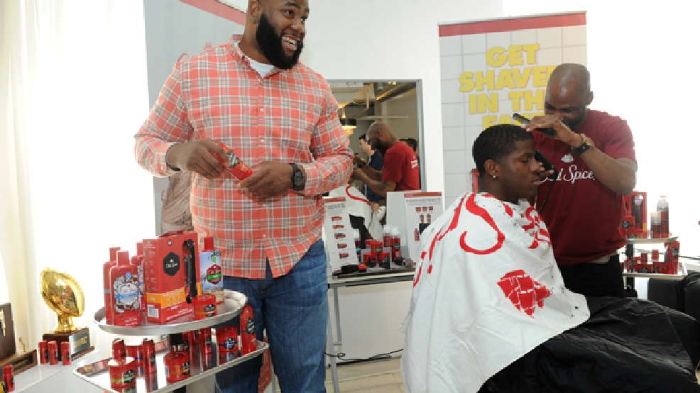 NFL prospect Morgan Moses, left, offensive tackle, Virginia, checks out Old Spice Cruise Control as fellow prospect Kony Ealy, defensive end, Missouri, gets a shape up at the Old Spice Grooming Bar at the Sean John Pre-Draft Gifting and Style Suite, Tuesday, May 6, 2014, in New York. (Photo by Diane Bondareff/Invision for Old Spice)