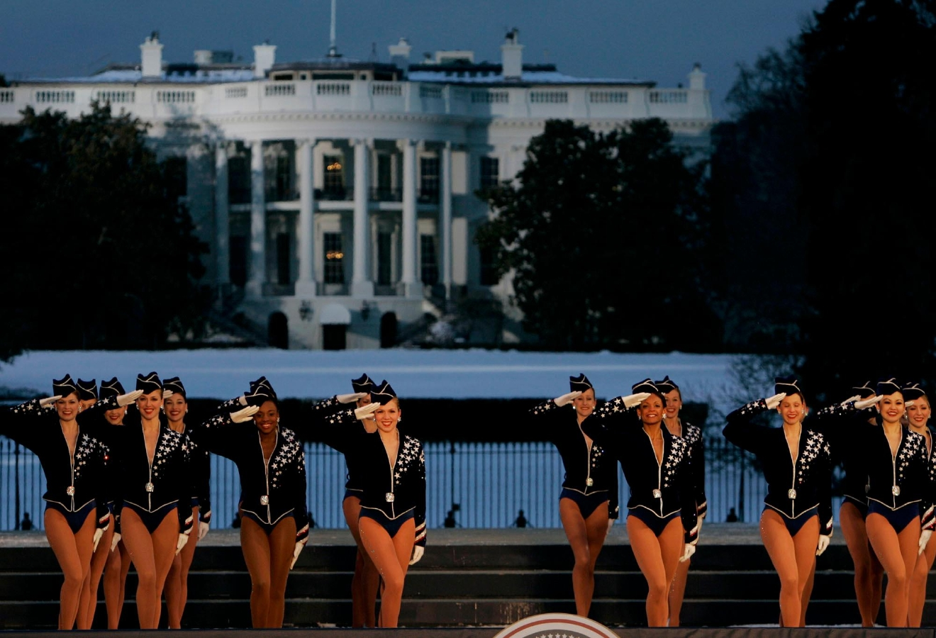 FILE - In this Wednesday, Jan. 19, 2005, file photo, the Rockettes perform during the Celebration of Freedom Concert on the Ellipse, with the White House in the background in Washington. The Radio City Rockettes have been assigned to dance at President-elect Donald Trump's inauguration January 2017. (AP Photo/Chris Gardner, File)