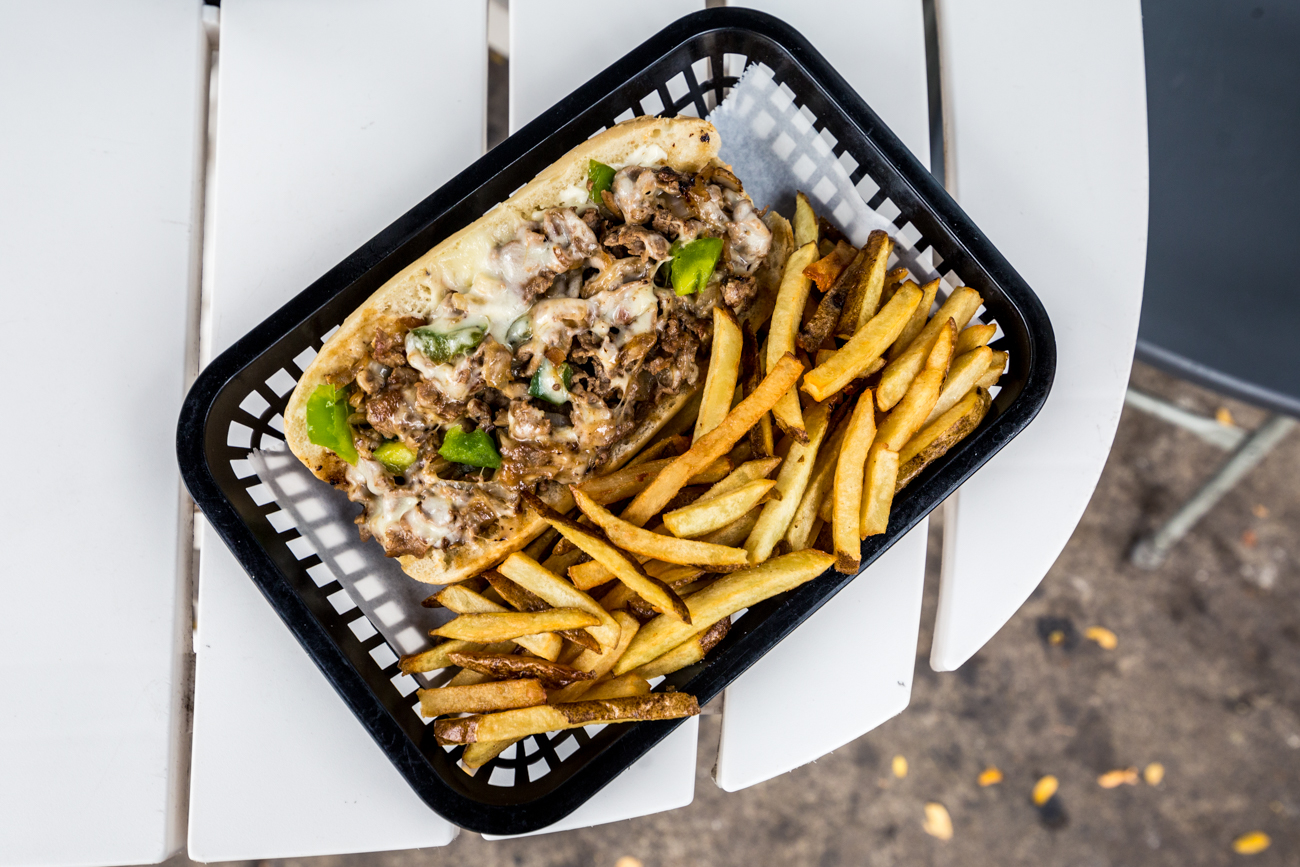 13th Street Alley's OTR Philly: classic Philly style cheese steak with 100 percent sirloin steak, thinly sliced and grilled, then topped with provolone, sautéed onions, mushrooms, green pepper, mayo and served with a side of fresh cut fries / Image: Catherine Viox{ }// Published: 11.12.19