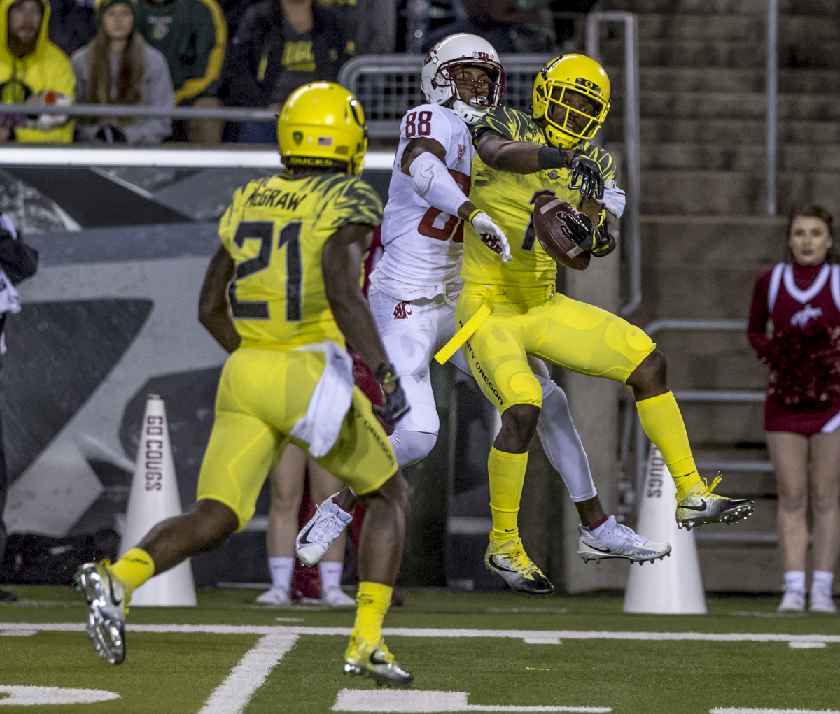 Oregon center back Arrion Springs (#1) breaks up a pass intended for Washington State wide receiver C.J. Dimry (#8). The Washington State Cougars defeated the Oregon Ducks 33 to 10 on Saturday, October 7, 2017. Saturday's game was the first home loss for the Ducks under new head coach Willie Taggart. Photo by Ben Lonergan, Oregon News Lab