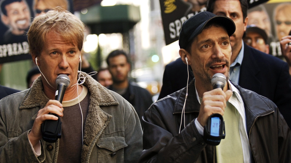 "In a April 26, 2006 file photo, radio shock jocks Greg ""Opie"" Hughes, left, and Anthony Cumia, right, leave CBS Radio studios on 57th Street with fans after finishing their first morning show, in New York. Cumia is offering no apologies for what satellite radio company SiriusXM called a hate-filled Twitter rant that got him fired. The former co-host of the ""Opie and Anthony Show"" was let go on July 3 after tweeting his outrage at a woman he said punched him in the face on a New York street. Cumia responded in an interview early Saturday, July 12, 2014, on Fox News' ""Red Eye."" His tweets used an expletive degrading to women, and SiriusXM called them ""racially charged."" The woman he encountered is black. (AP Photo/ Louis Lanzano, File)"