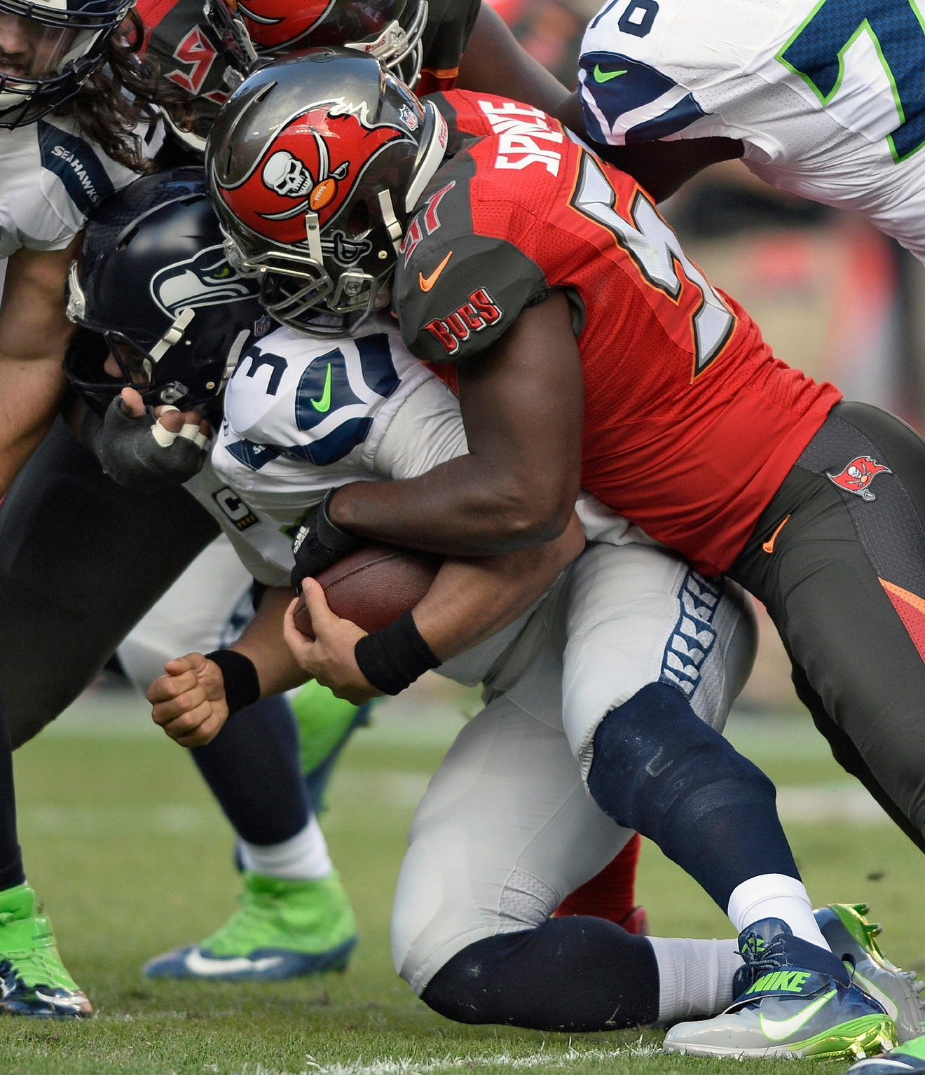 Tampa Bay Buccaneers defensive end Noah Spence (57) sacks Seattle Seahawks quarterback Russell Wilson (3) during the first quarter of an NFL football game Sunday, Nov. 27, 2016, in Tampa, Fla. (AP Photo/Jason Behnken)