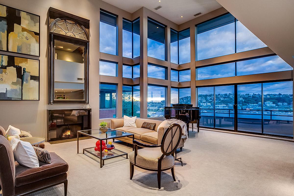 Open the doors and gaze upon the luxurious and unobstructed views that will drop your darn jaw to the floor. Saunter (preferably with a glass of wine in hand) around the 3,860 square foot dream and peek into the three bedrooms and 2.75 bathrooms. (Image: Windermere)