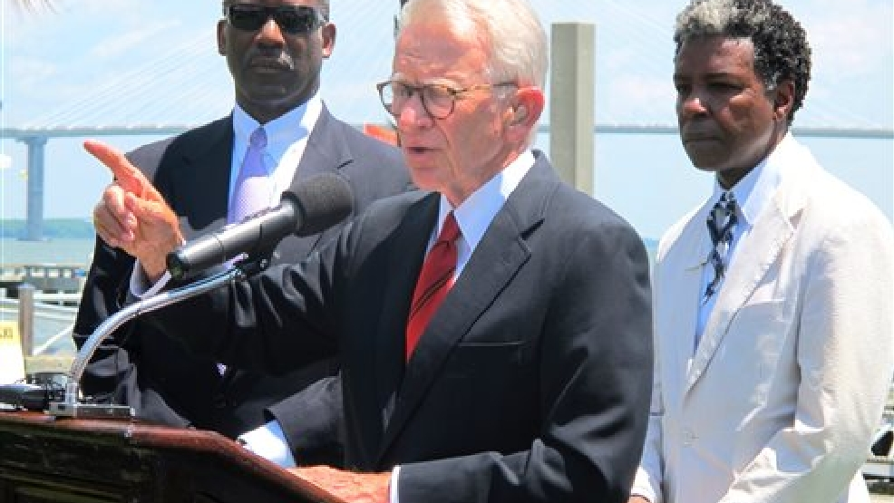 Mayor Joseph P. Riley Jr., center, announces that a $75 million International African American Museum will be built at the site of a wharf in Charleston, during a July 15, 2014 news conference in Charleston, S.C. The site is where tens of thousands of slaves first set foot in the United States. Behind the mayor are Wilbur Johnson, left, the chairman of the board of the museum, and artist Jonathan Green, whose colorful paintings of the black culture of the sea islands of the Southeast coast are in collections worldwide. Riley said construction of the museum could begin in early 2016 with completion two years later. (AP Photo/Bruce Smith)