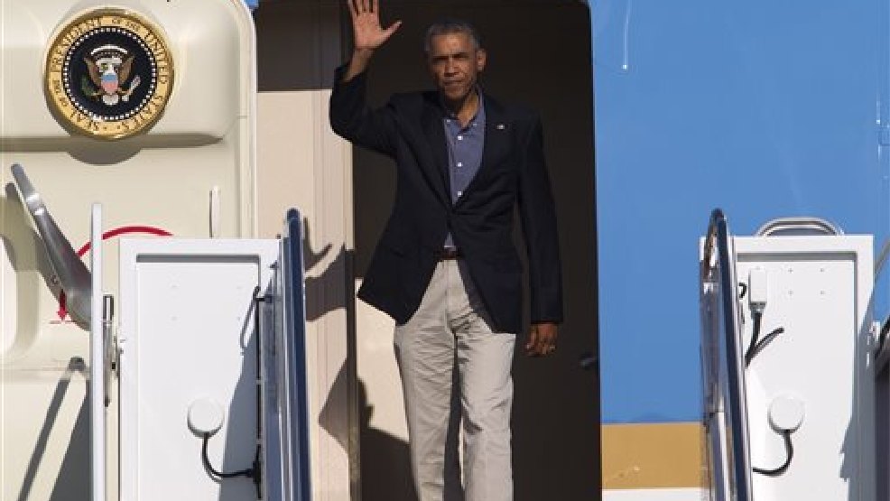 President Barack Obama waves from Air Force One upon arrival at Andrews Air Force Base, Md., Monday, Sept. 1, 2014. (AP Photo/Jose Luis Magana)