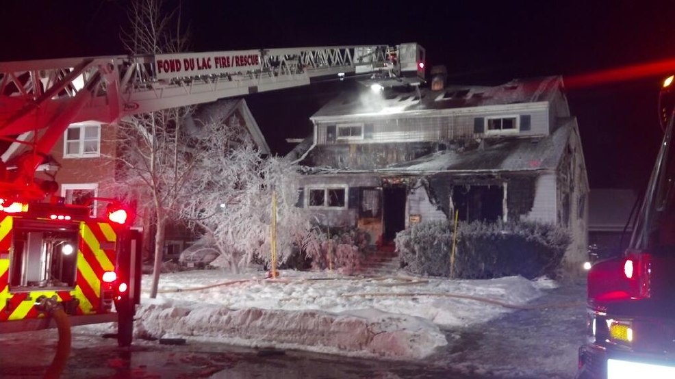 Fond du Lac firefighters battle a house fire, Jan. 24, 2014. (WLUK/Emily Deem)
