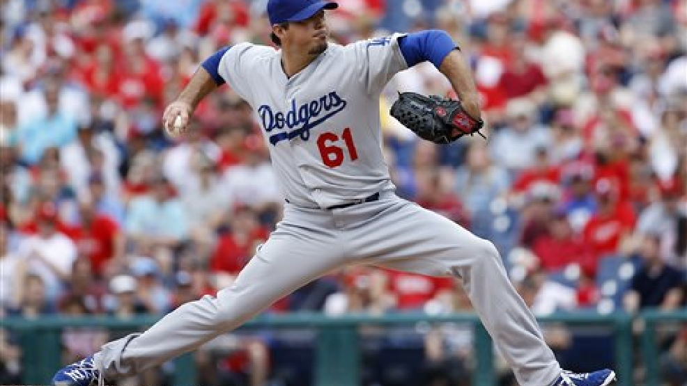 Los Angeles Dodgers' Josh Beckett pitches during the first inning of a baseball game against the Philadelphia Phillies, Sunday, May 25, 2014, in Philadelphia. (AP Photo/Matt Slocum)