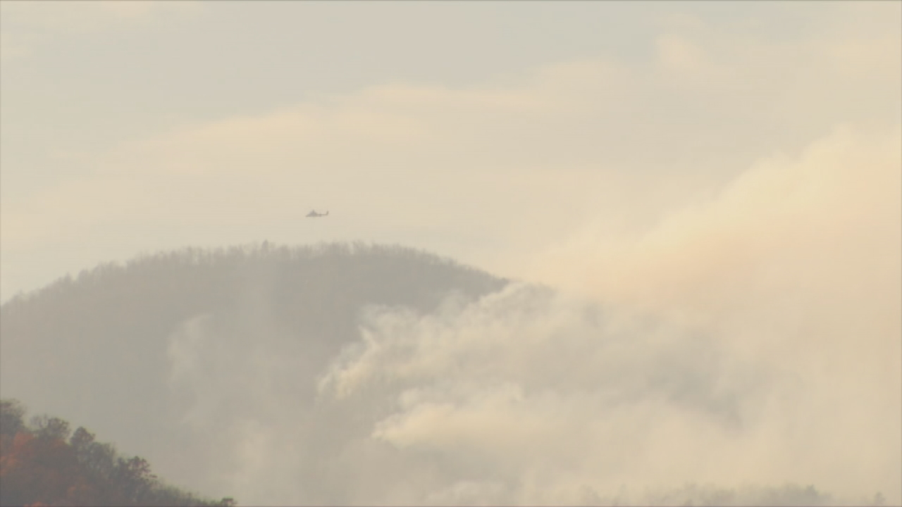 U.S. Forest Service fire analyst Jon Rieck says he believes in global warming, and says it could have a role in the extensive drought and unseasonably mild weather that continues to fuel Western North Carolina's forest fires. (Photo credit: WLOS staff)