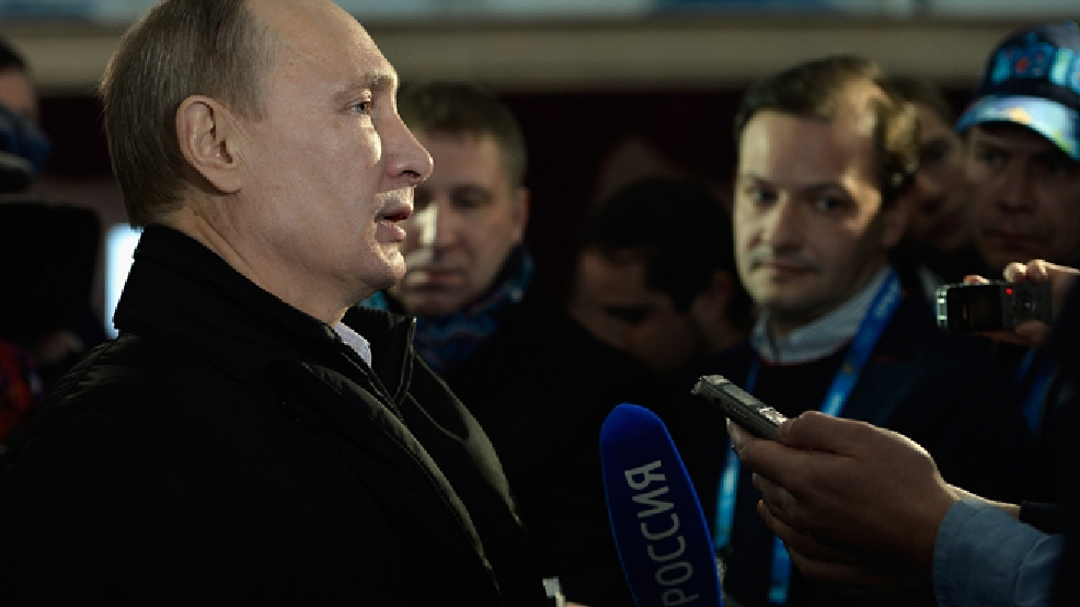 Russian President Vladimir Putin speaks to the media while visiting the Coastal Cluster Olympic Village ahead of the 2014 Winter Olympics on Wednesday, Feb. 5, in Sochi, Russia. (AP Photo/Pascal Le Segretain, Pool)