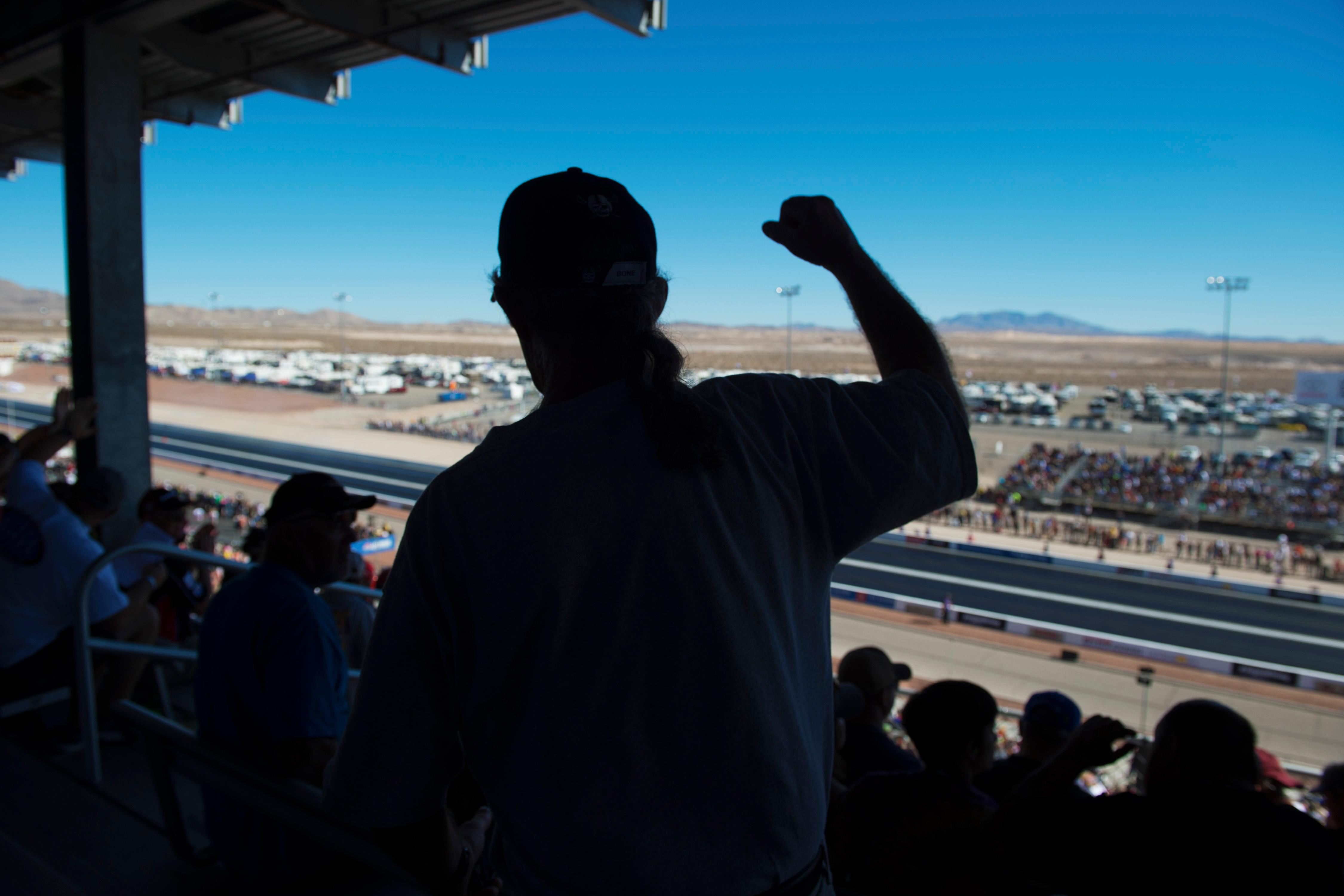 A fan cheers on a favorite driver at the NHRA Toyota Nationals Sunday, October 29, 2017, at The Strip at the Las Vegas Motor Speedway. CREDIT: Sam Morris/Las Vegas News Bureau
