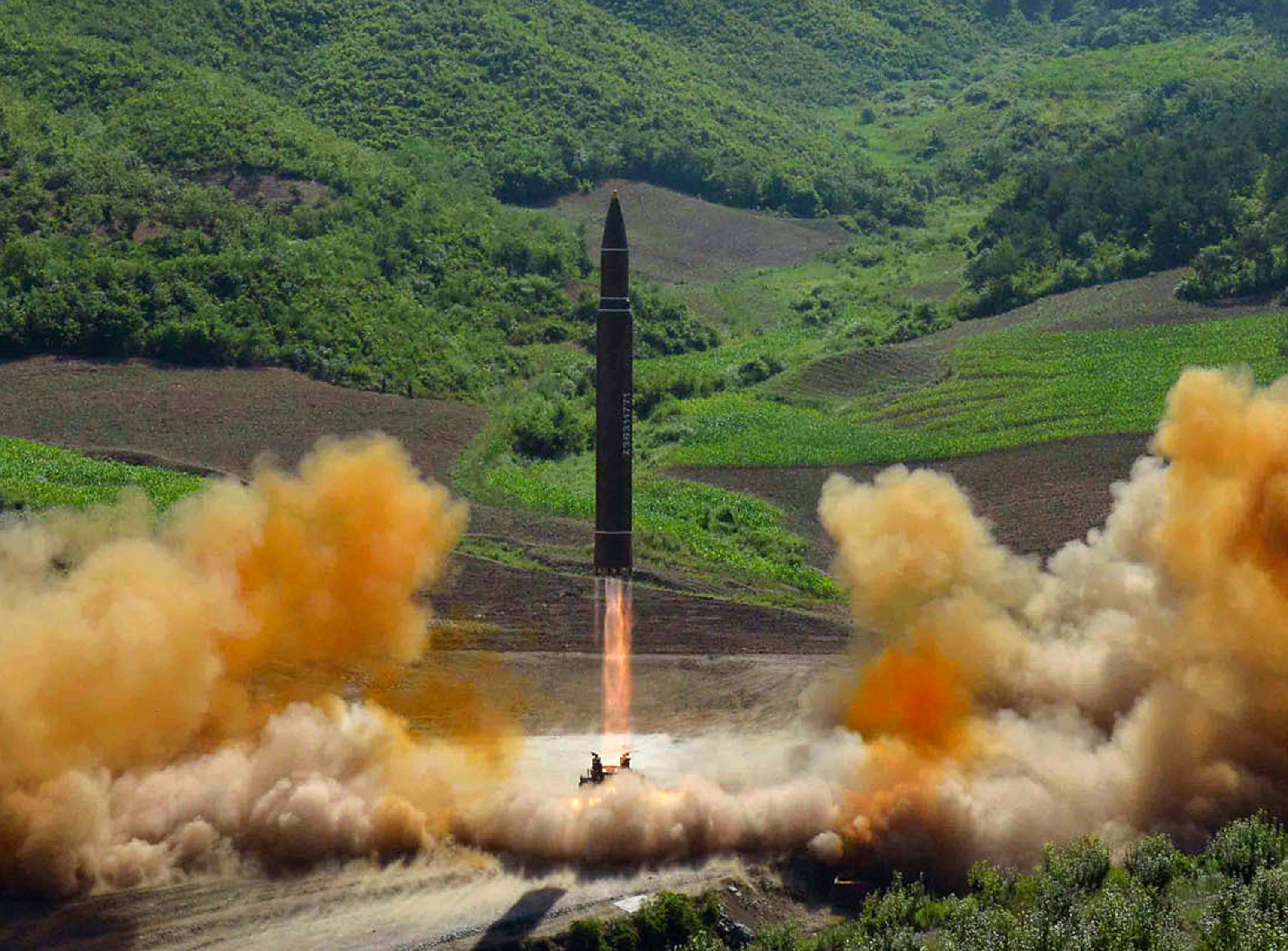 FILE - This file photo distributed by the North Korean government shows what was said to be the launch of a Hwasong-14 intercontinental ballistic missile, ICBM, in North Korea's northwest, Tuesday, July 4, 2017. Independent journalists were not given access to cover the event depicted in this photo. No need to duck and cover just yet. U.S. intelligence officials are pretty sure North Korea can put a nuclear warhead on an intercontinental missile that could reach the United States. Experts aren't convinced the bomb could survive the flight to America. (Korean Central News Agency/Korea News Service via AP, File)