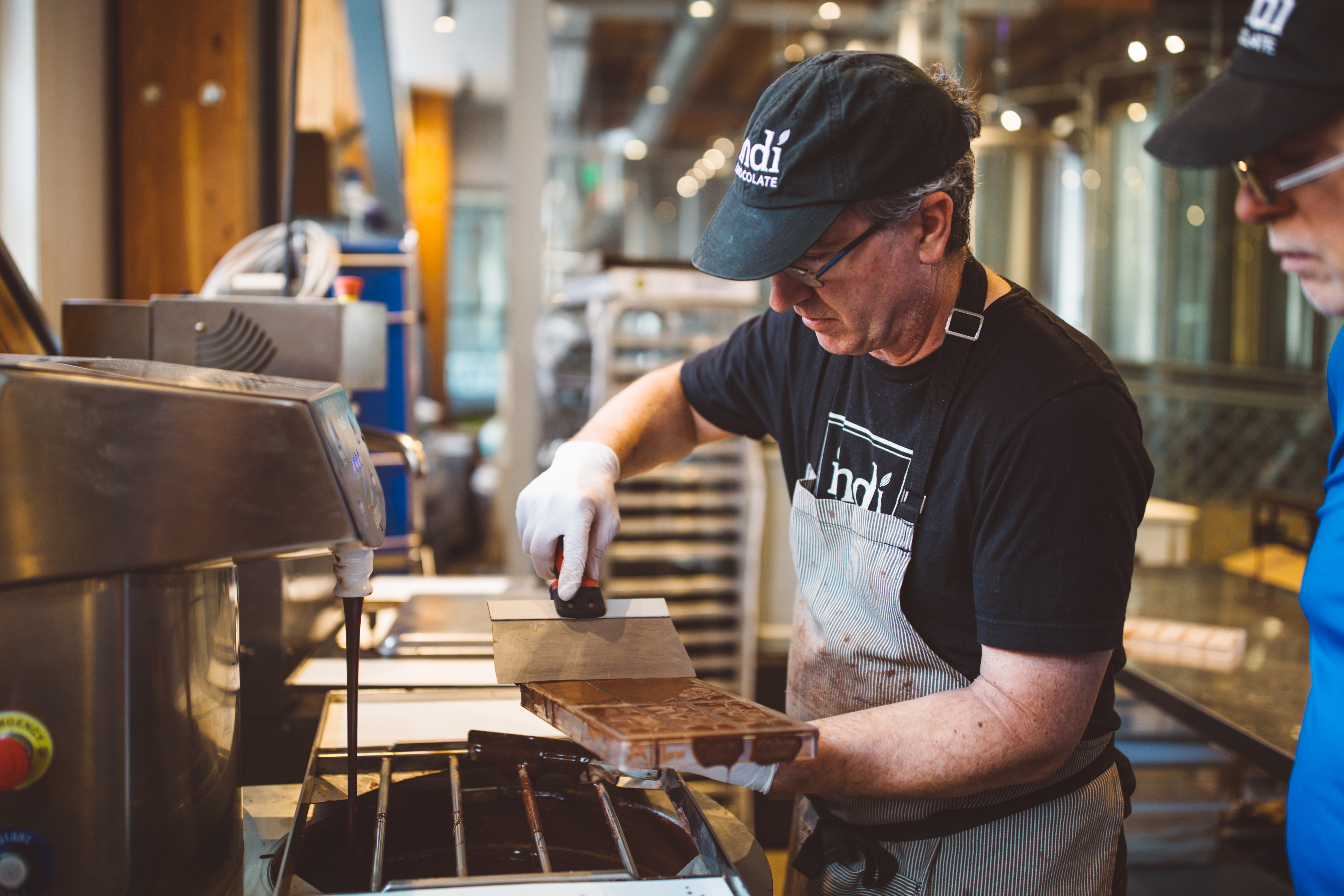 <p>The refined chocolate is then tempered, where it acquires its shiny and snappy characteristics.{&amp;nbsp;} Once it has been adequately tempered, the chocolate is finally poured into a desired mold. Vibration is used to get out any air bubbles, and the chocolate is then cooled until it hardens. (Image: Ryan McBoyle / Seattle Refined)</p>