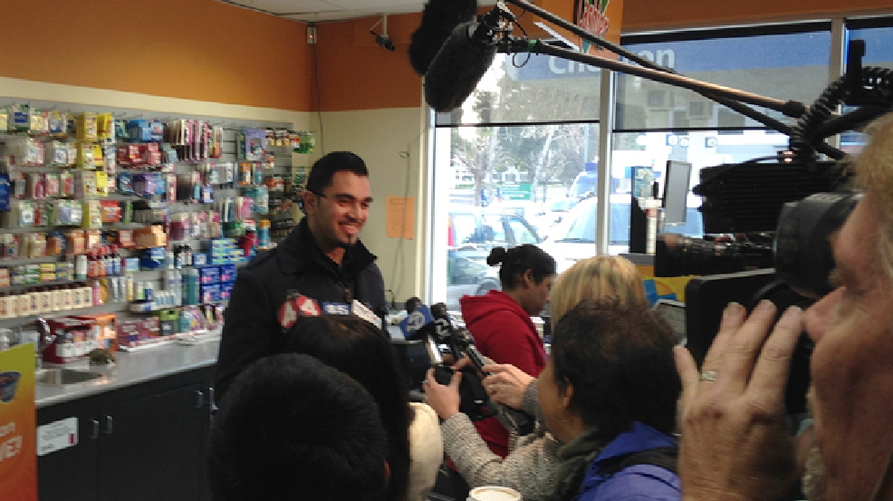 Parmeet Singh, son of Dixon Landing Chevron store owner Kulwinder Singh, speaks to reporters at the store in Milpitas, Calif., on Thursday, Feb. 20, 2014. According to California lottery officials, the store sold the lone winning ticket for a $425 million Powerball jackpot but there was no immediate word on who may have won one of the largest lottery jackpots in U.S. history. (AP Photo/Martha Mendoza)