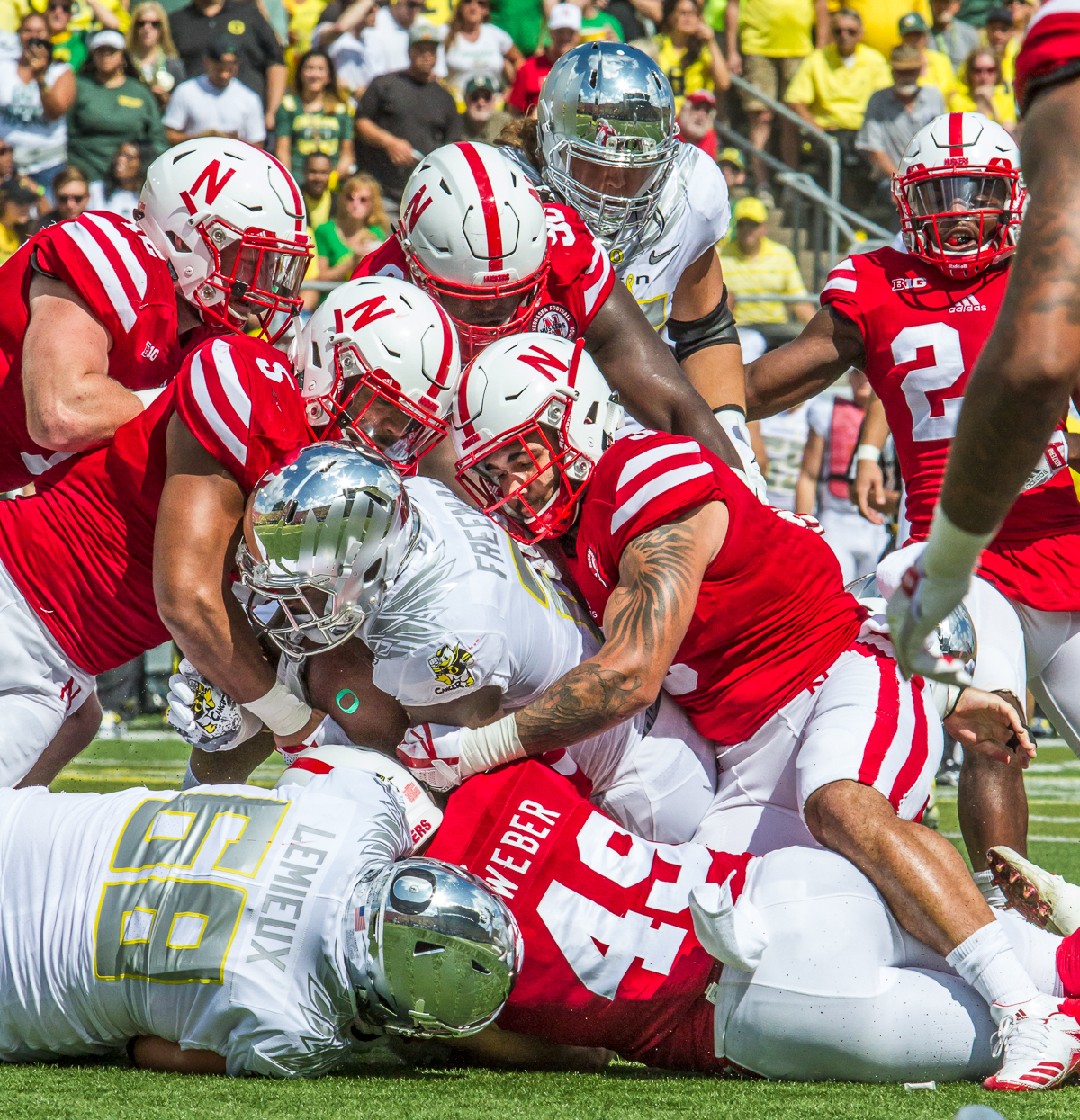 Oregon running back Royce Freeman (#21) is brought down by the Nebraska defense. The Oregon Ducks lead the Nebraska Cornhuskers 42 to 14 at the end of the first half on Saturday, September 9, 2017. Photo by Ben Lonergan, Oregon News Lab