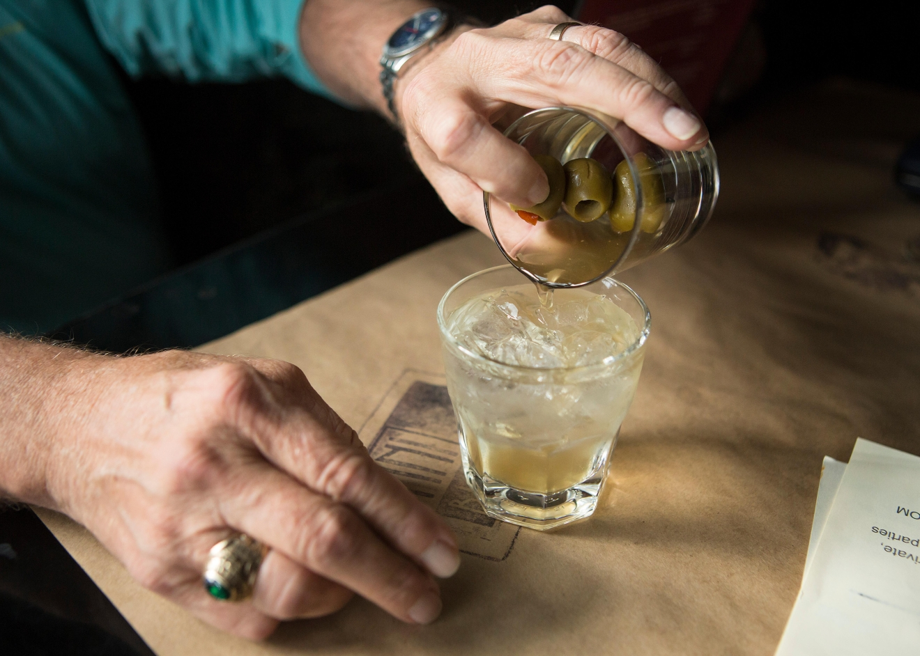 Bob Goodman likes to pour his own martini at Tini Bigs Lounge. The bar has served Seattle for over 20 years. (Sy Bean / Seattle Refined)