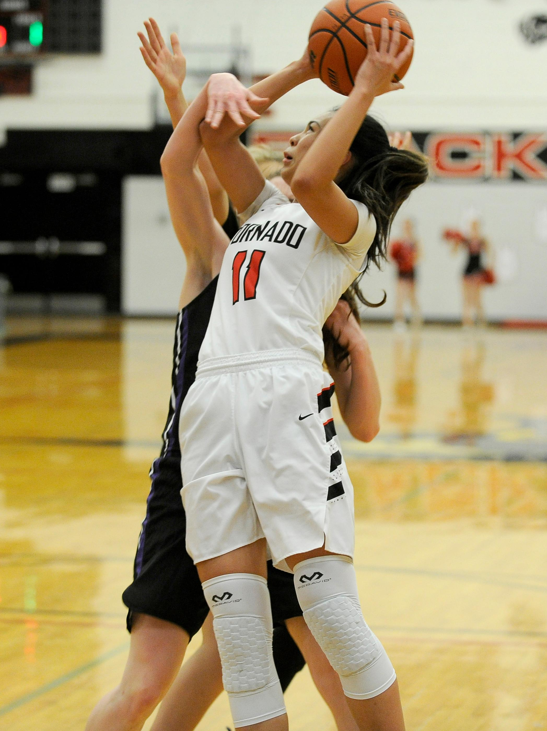 Andy Atkinson / Mail TribuneNorth's Talia Baker gets fouled going to the rim in the 1st quarter.