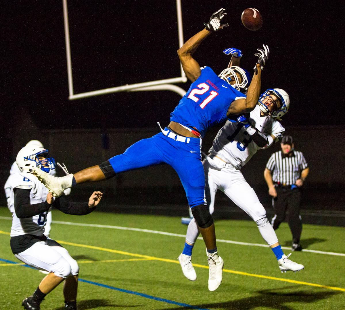 Churchill Lancers wide receiver Lucas Wilson (#21) jumps for a pass. Eagle Point defeated Churchill 42-37. Photo by Justin Hartney, Oregon News Lab