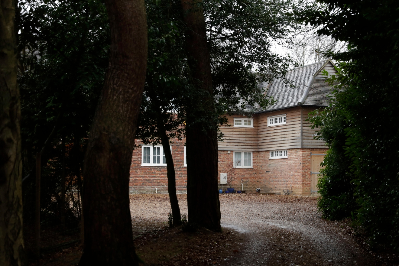 A view shows a house believed to be where Christopher Steele lives in Farnham, England, Thursday Jan. 12, 2017.  An unsubstantiated dossier on US President elect, Donald Trump, has been circulating in Washington for months and The Wall Street Journal on Wednesday Jan. 11, identified the dossier's author as Christopher Steele, a director of London-based Orbis Business Intelligence Ltd. (AP Photo/Matt Dunham)