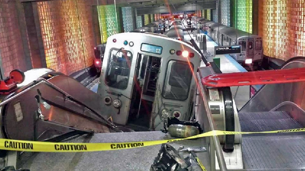 "A Chicago Transit Authority train car rests on an escalator at the O'Hare Airport station after it derailed early Monday, March 24, 2014, in Chicago. More than 30 people were injured after the train ""climbed over the last stop, jumped up on the sidewalk and then went up the stairs and escalator,"" according to Chicago Fire Commissioner Jose Santiago. (AP Photo/NBC Chicago, Kenneth Webster)"