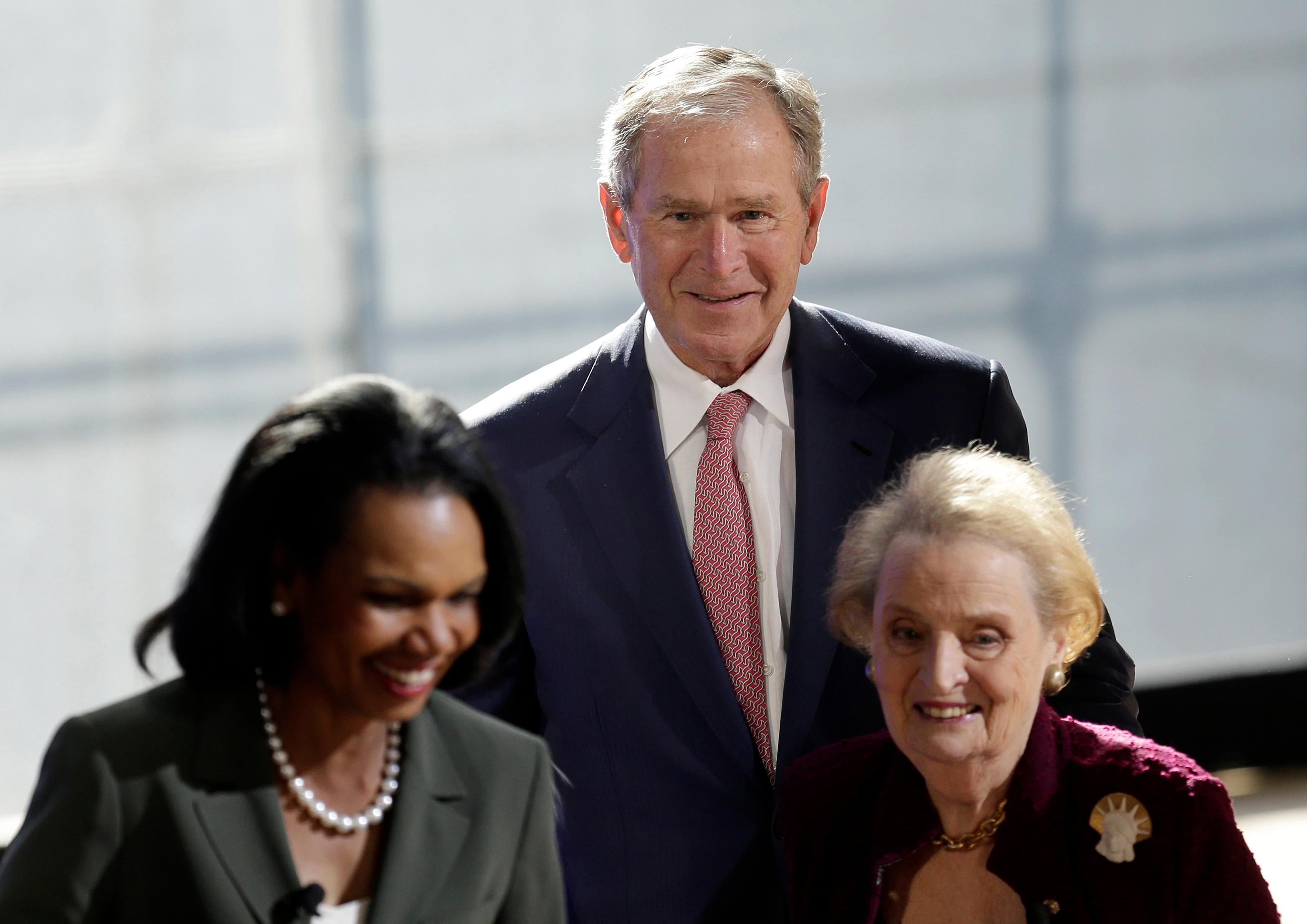 Former U.S. President George W. Bush greets former U.S. Secretary of State  Condoleezza Rice, left, and Madeleine Albright, right, after they participated in a panel discussion at a forum sponsored by the George W. Bush Institute in New York, Thursday, Oct. 19, 2017. (AP Photo/Seth Wenig)
