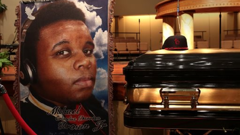 The casket of Michael Brown sits inside Friendly Temple Missionary Baptist Church awaiting the start of his funeral on Monday, Aug. 25, 2014. Brown, who is black, was unarmed when he was shot Aug. 9 in Ferguson, Mo., by Officer Darren Wilson, who is white. Protesters took to the streets of the St. Louis suburb night after night, calling for change and drawing national attention to issues surrounding race and policing. (AP Photo/St. Louis Post Dispatch, Robert Cohen, Pool)