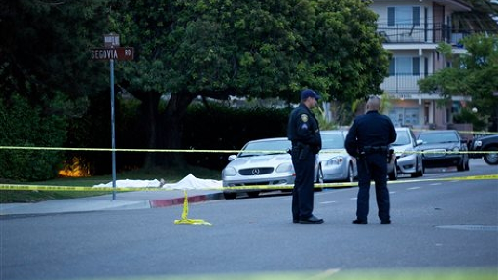 Police wait at the scene after a drive-by shooting left seven people dead, including the attacker, and others wounded on Friday, May 23, 2014, in Isla Vista, Calif. Alan Shifman an attorney for Hollywood director Peter Rodger, who was an assistant director on The Hunger Games, said the family believes Rodger's son, Elliot Rodger, is responsible for the shooting rampage near the Santa Barbara, California, university campus. Authorities have not confirmed the identity of the shooter. (AP Photo/The News-Press, Peter Vandenbelt)