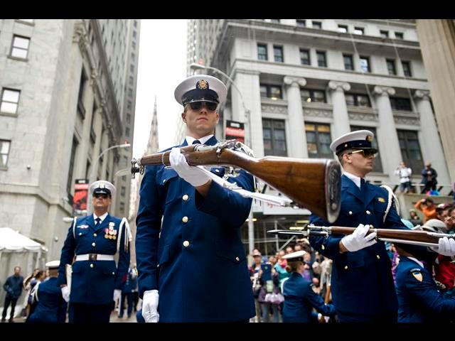 A member of the Coast Guard Ceremonial Honor Guard silent drill team performs a rifle movement during a demonstration for Fleet Week in front of the New York Stock Exchange during Fleet Week in New York City, May 22, 2014.