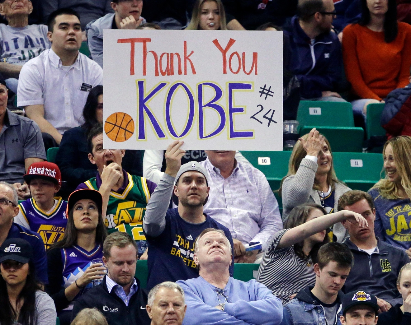 A fan holds a sign for Los Angeles Lakers forward Kobe Bryant during the second quarter of an NBA basketball game against the Utah Jazz on Monday, March 28, 2016, in Salt Lake City. (AP Photo/Rick Bowmer)