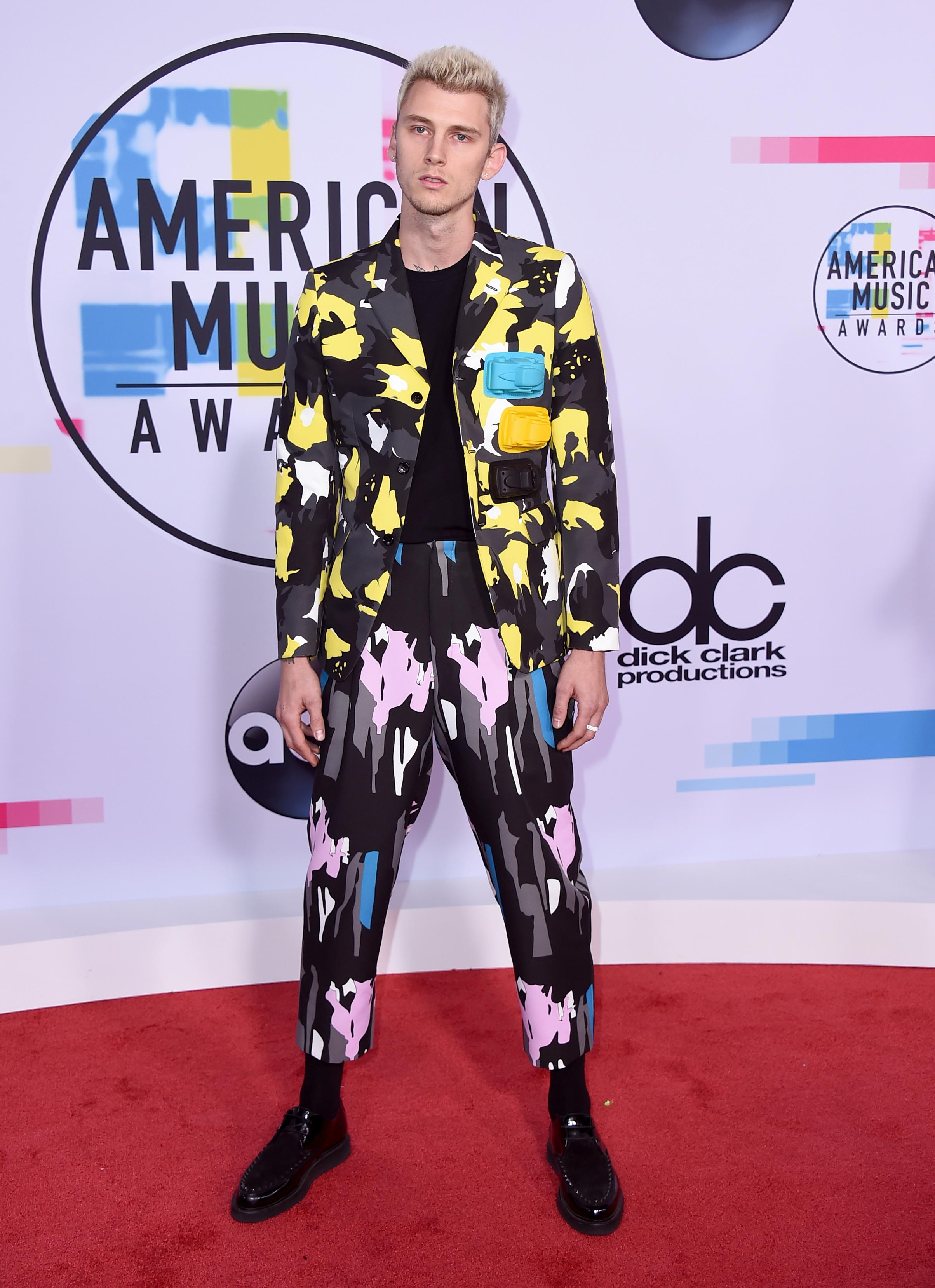 Machine Gun Kelly arrives at the American Music Awards at the Microsoft Theater on Sunday, Nov. 19, 2017, in Los Angeles. (Photo by Jordan Strauss/Invision/AP)