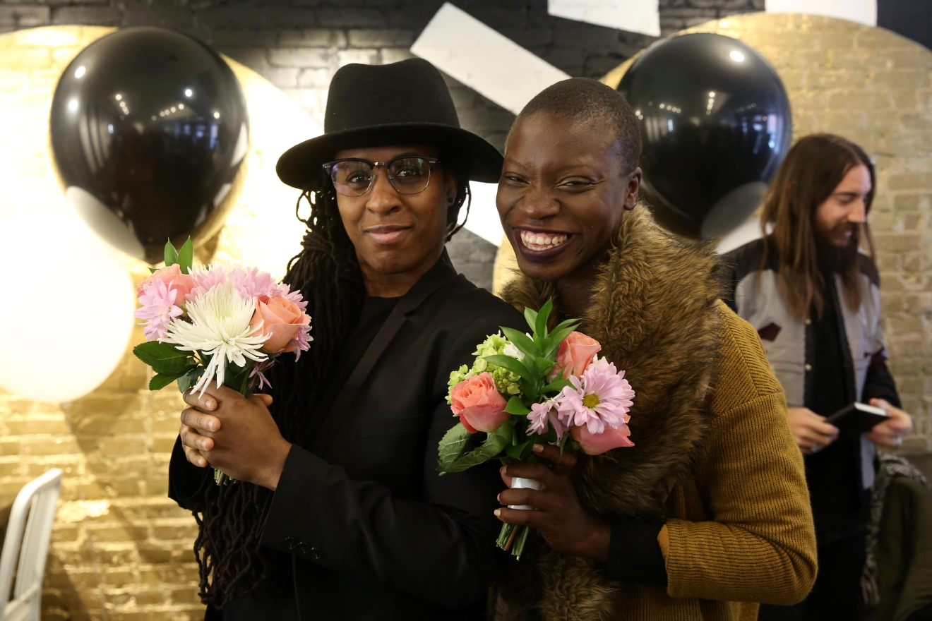 Friends Omi Williams and Jessica Nabongo caught the bouquets. (Amanda Andrade-Rhoades/DC Refined)